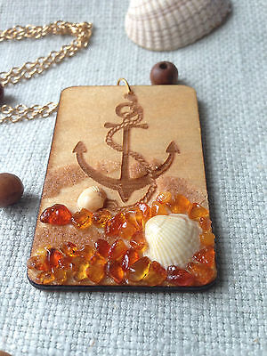 Wooden necklace pendant with anchor decorated with genuine Baltic amber.