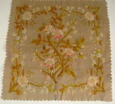 Antique embroidery of flowers on wool