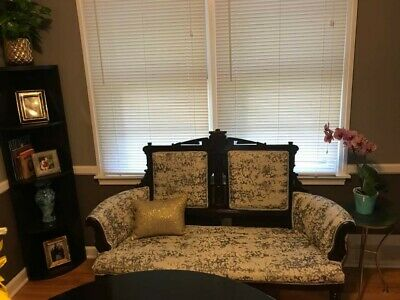 Loveseat: Victorian Eastlake Settee. Cream upholstery with blue finish.
