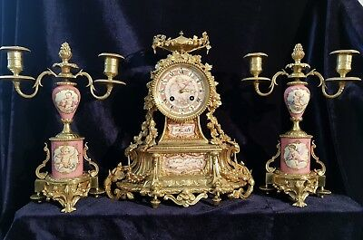 French gilt bronze clock set with Sevres style pink ground porcelain panels