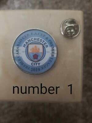Man city treble badges  10% of all sales go to macmillan cancer support