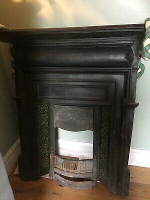 Original cast iron fire place with original tiles in perfect condition