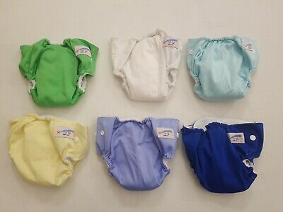 Lot of 6 one size(S) reusable cloth diaper unisex. Multi colors