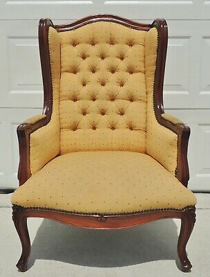 Antique/Vtg Solid Mahogany carved Upholstered Wing Arm Chair Brass Studs