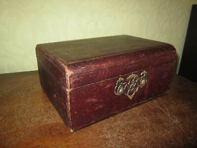 An antique leather jewellery box