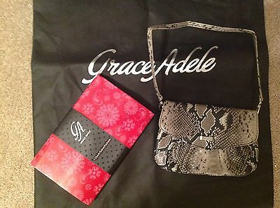 Brand New Grace Adele Elegant Jane Python Clutch with tags on