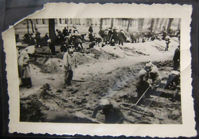 Original Holocaust artifact photograph of civilians under guard digging graves