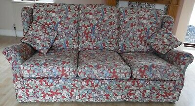 Two beautiful hand upholstered floral sofas and armchair, traditional style