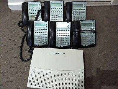 NEC XEN Topaz phone system with 7 digital handsets. Tested working.