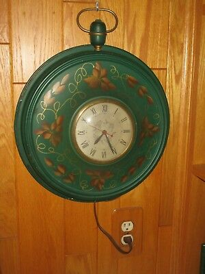 Vintage Sessions round wall clock electric,  in working order.