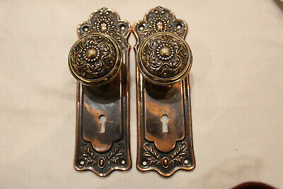 E-13710 Norwich in Flashed Copper Finish Incls: Knobs, Escutcheons, and Mortise