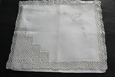 Vintage white linen lingerie or nightdress case with white embroidery.