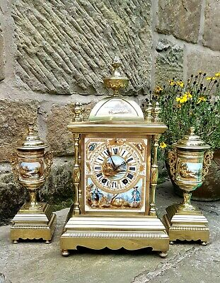 A stunning French clock set circa 1880 Beautiful hand painted porcelain + urns