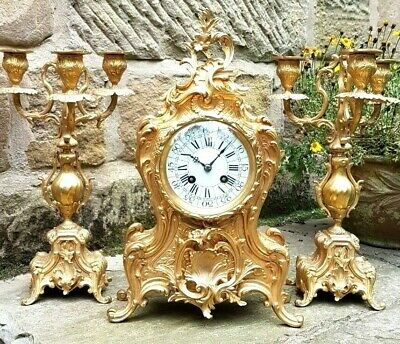 A fine 19th Century gilded brass clock set with candelabra by A Chapus, Paris