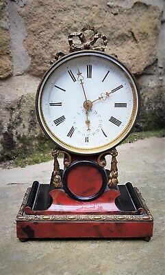 A nice little French drum head timepiece with date display and makers stamp A G