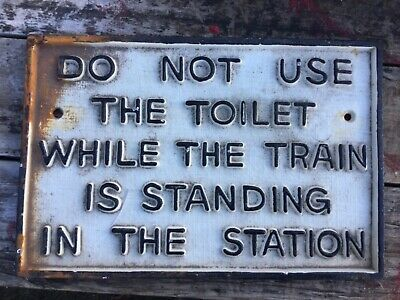 """Vintage early reproduction  """"DO NOT USE THE TOILET WHILE STANDING IN THE STATION"""