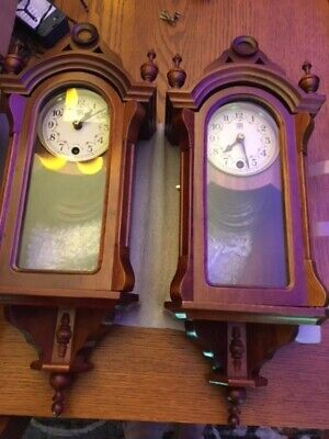2 (a pair) of matching antique wooden wall clocks.