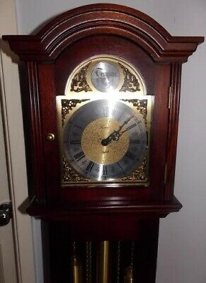 Tempus Fugit Granddaughter clock.  Dark Mahogany, good condition & working order