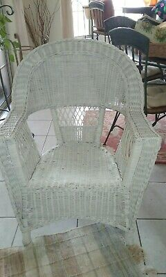 Antique white wicker chair flat arm and braided all around the edges.Excellent