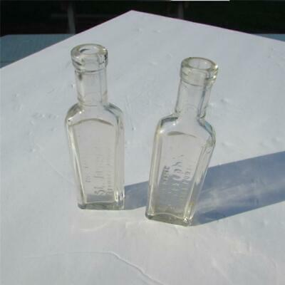 """2 St. Joseph's Clear Medicine Bottles, Apothecary, """"The Name Assures Purity"""""""