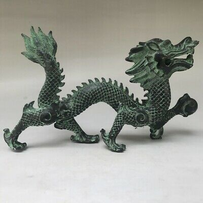 A HAND-MADE DRAGON STATUE OF AN ANCIENT CHINESE METAL OBJECT g97