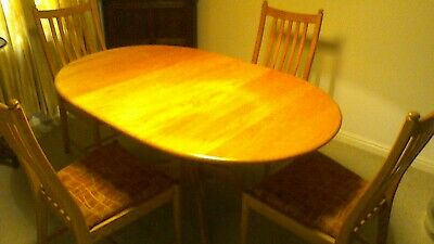 Ercol extending dining table and chairs