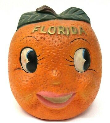 older large FLORIDA ORANGE smiling face paper mache penny still ban with trap