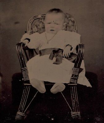 Old Vintage Antique Tintype Photo Unhappy Baby Child Strapped To Wicker Chair