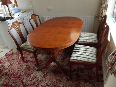 'Antique style' mahogany dining table with claw feet and 4 chairs.
