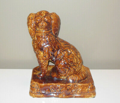 Antique Rockingham Glaze Yellow Ware Seated Spaniel King Charles Dog Door Stop