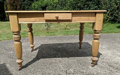 Antique pine table, with elegantly carved legs, seats 4 perfectly