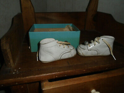 Vintage pair of white leather baby shoes in original box but no lid