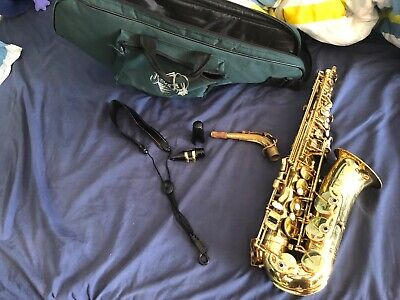 USED ALTO SAX with a case, mouth piece, 4 reeds, and a notch