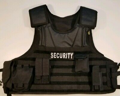 Voodoo Tactical F.A.S.T. Vest with MOLLE Webbing. Setup for Security Contractor.