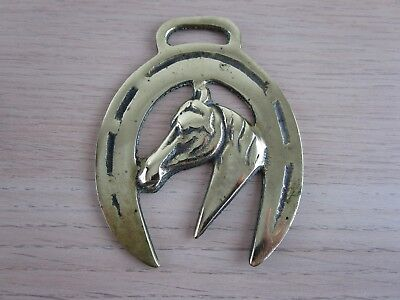 Vintage Horse Brass horse's head framed in a lucky horse shoe facing left