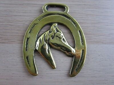 Vintage Horse Brass horse's head framed in a lucky horse shoe facing right
