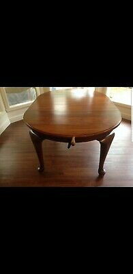 Antique blackwood extendable dining table and six chairs .