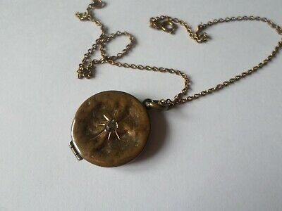 Antique Victorian or Edwardian locket with 2 photos inside