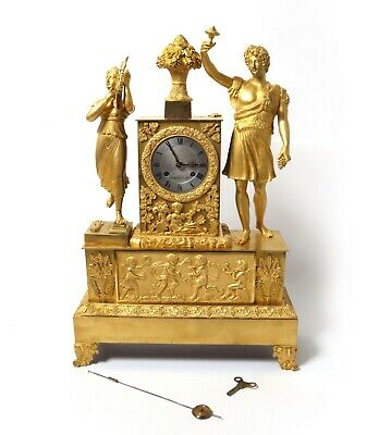 Bronze mantel clock with a fight.  France, the first half of the 19th century.
