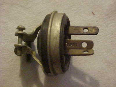 1 NOS BRYANT Industrial Metal Strap & Hard Rubber 3 Prong Clamp On Plug Voltage?