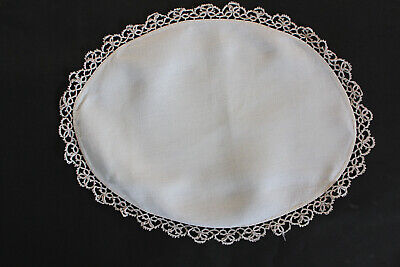 Vintage cream linen oval shaped cloth with crochet edges.