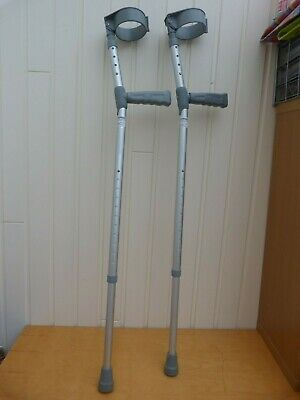 A Pair Of Coopers Double Adjustable Elbow Lightweight Crutches PVC