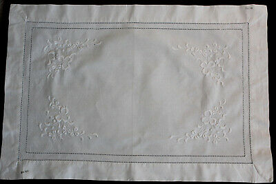 Vintage rectangular white linen tray cloth with white embroidered flowers.