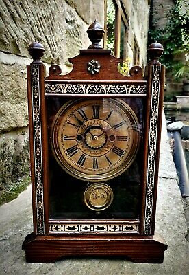 A wonderful early cased bell striking alarm clock by H.A.C - Good working order