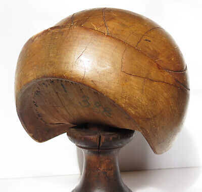 A PERIOD EARLY 20TH CENTURY FORMED HAT BLOCK (Stand not included)
