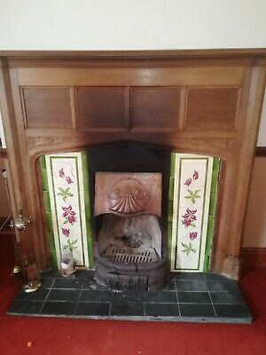 Large wooden and tiled Edwardian farmhouse fire surround fireplace.