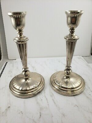 Pair Of Cartier Sterling Silver Candlesticks London