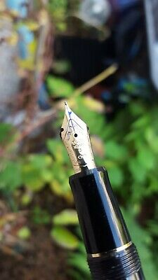 Pilot Custom 74 fountain pen with medium nib and black and gold body.