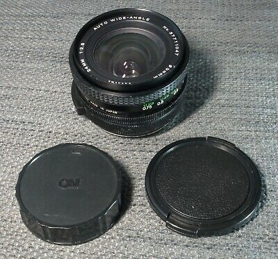 Olympus OM fit Vivitar 24mm f 2.8 lens with lens caps