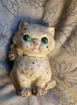 Antique  old Hubley Cast Iron Cat/Kitten Bank With Green Bow with flowers.